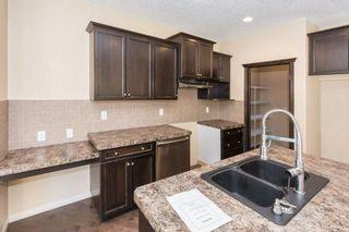 Photo 8: 436 HIDDEN CREEK Boulevard NW in Calgary: Panorama Hills House for sale : MLS®# C4161633
