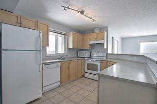 Photo 18: 7402 304 MacKenzie Way SW: Airdrie Apartment for sale : MLS®# A1081028