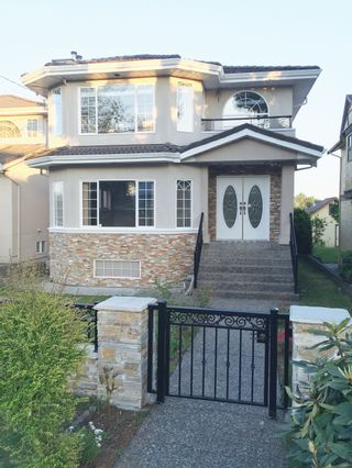 Photo 1: 7578 14TH AVE - LISTED BY SUTTON CENTRE REALTY in Burnaby: Edmonds BE House for sale (Burnaby East)  : MLS®# V1118101