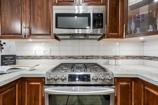 Photo 3: B424 20716 WILLOUGHBY TOWN CENTRE Drive in Langley: Willoughby Heights Condo for sale : MLS®# R2607429
