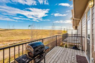 Photo 11: 504 Panatella Walk NW in Calgary: Panorama Hills Row/Townhouse for sale : MLS®# A1153133