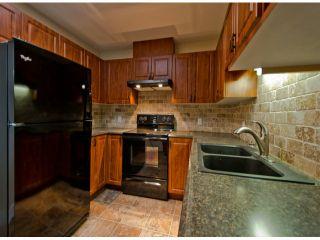 "Photo 5: 404 10128 132ND Street in Surrey: Cedar Hills Condo for sale in ""MELROSE GARDENS"" (North Surrey)  : MLS®# F1304973"