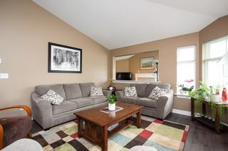 """Photo 4: 49 8555 209 Street in Langley: Walnut Grove Townhouse for sale in """"Autumnwood"""" : MLS®# R2154627"""
