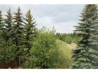 Photo 34: 108 WEST TERRACE Point(e): Cochrane House for sale : MLS®# C4077226