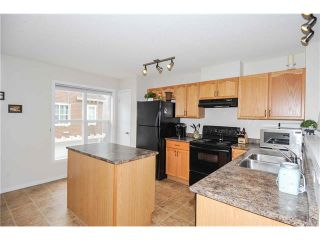 Photo 12: 318 TOSCANA Gardens NW in Calgary: Tuscany House for sale : MLS®# C4116517