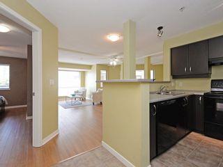 Photo 2: 215 10866 CITY Parkway in Surrey: Whalley Condo for sale (North Surrey)  : MLS®# R2190460