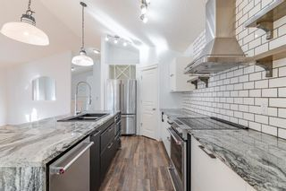 Photo 6: 48 West Springs Way SW in Calgary: West Springs Row/Townhouse for sale : MLS®# A1148807