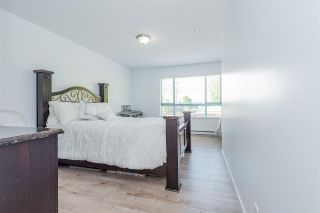 """Photo 15: 209 223 MOUNTAIN Highway in North Vancouver: Lynnmour Condo for sale in """"Mountain Village"""" : MLS®# R2588794"""
