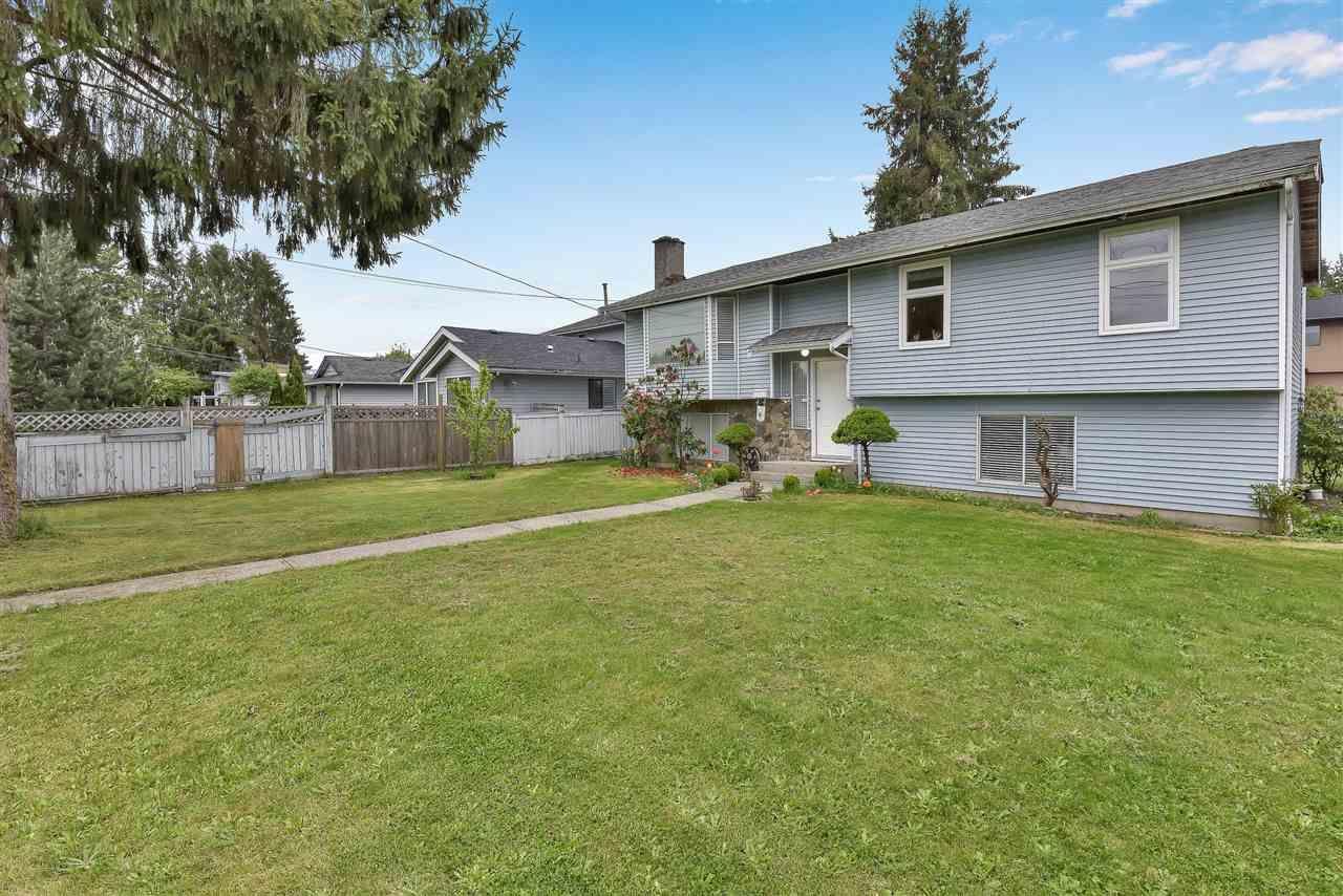 Main Photo: 14888 96 Avenue in Surrey: Fleetwood Tynehead House for sale : MLS®# R2575154