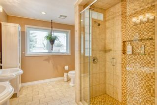 Photo 12: 131 Queensland Circle SE in Calgary: Queensland Detached for sale : MLS®# A1148253