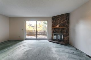 Photo 4: 109 3131 63 Avenue SW in Calgary: Lakeview Row/Townhouse for sale : MLS®# A1151167