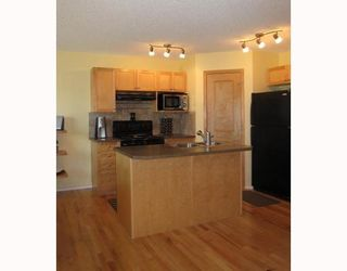 Photo 4: 231 COVEMEADOW Crescent NE in CALGARY: Coventry Hills Residential Attached for sale (Calgary)  : MLS®# C3387195