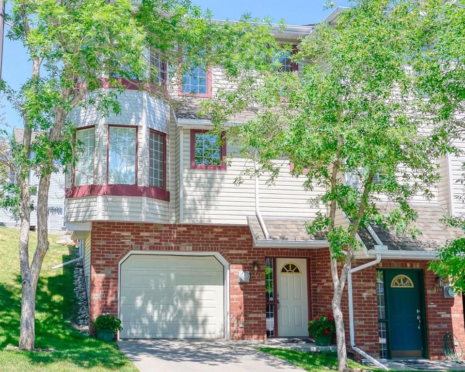 Main Photo: 5471 Patina Drive SW in Calgary: Patterson Row/Townhouse for sale : MLS®# A1126080