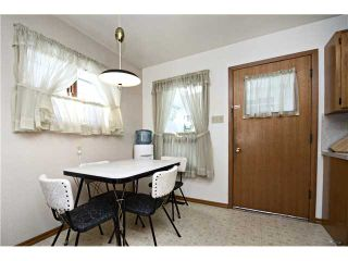 Photo 8: 3112 LANCASTER Way SW in Calgary: Lakeview House for sale : MLS®# C3654230