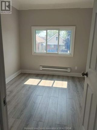 Photo 3: 900 ELSMERE Unit# A in Windsor: House for lease : MLS®# 21002807