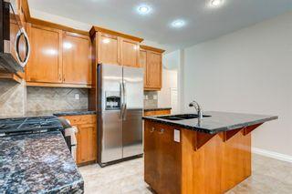 Photo 9: 4111 Garrison Boulevard SW in Calgary: Garrison Woods Row/Townhouse for sale : MLS®# A1108505