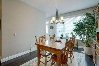 Photo 10: 340 Quarry Park Boulevard SE in Calgary: Douglasdale/Glen Row/Townhouse for sale : MLS®# A1123884