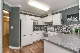 """Photo 14: 413 13900 HYLAND Road in Surrey: East Newton Townhouse for sale in """"Hyland Grove"""" : MLS®# R2589774"""