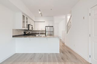 """Photo 1: 218 13958 108 Avenue in Surrey: Whalley Townhouse for sale in """"AURA 3"""" (North Surrey)  : MLS®# R2622290"""
