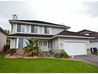 """Photo 1: 18865 61A Avenue in Surrey: Cloverdale BC House for sale in """"Falcon Ridge"""" (Cloverdale)  : MLS®# F1312984"""