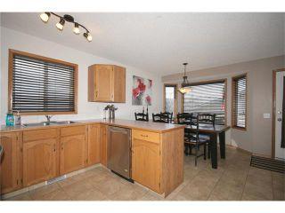 Photo 12: 35 WEST MCDOUGAL Road: Cochrane House for sale : MLS®# C4053037