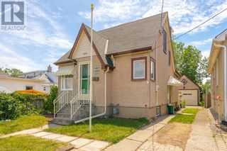 Photo 1: 154 CARLTON Street in St. Catharines: House for sale : MLS®# 40116173