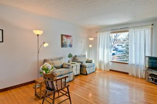Photo 5: 105 Langton Drive SW in Calgary: North Glenmore Park Detached for sale : MLS®# A1066568