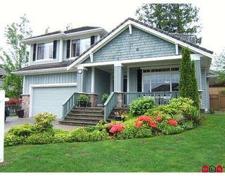 """Photo 1: 7371 147A Street in Surrey: East Newton House for sale in """"Chimney Heights"""" : MLS®# F2911537"""