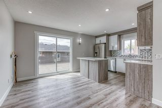 Photo 4: 5233 Martin Crossing Drive NE in Calgary: Martindale Detached for sale : MLS®# A1110063