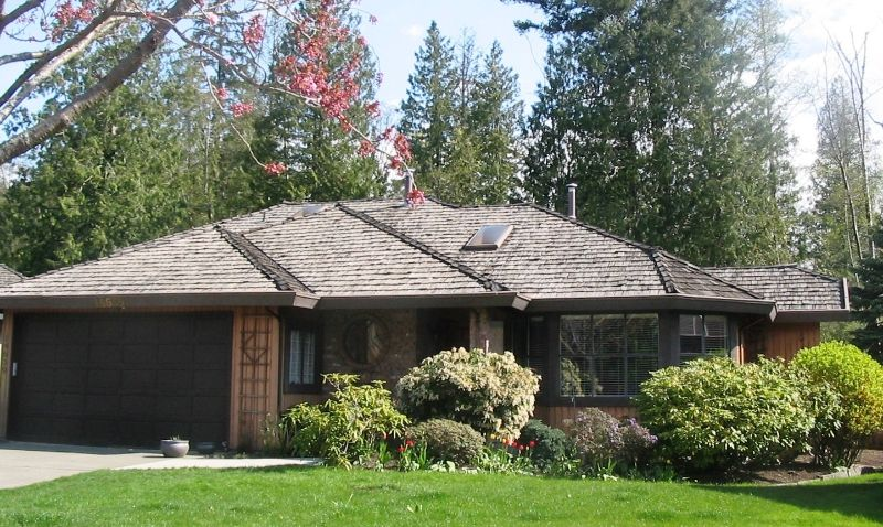 Mature trees and landscaping frame this lovingly renewed rancher nestled on quiet but central cul-de-sac