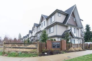 "Photo 1: 30 6971 122 Street in Surrey: West Newton Townhouse for sale in ""Aura"" : MLS®# R2440521"