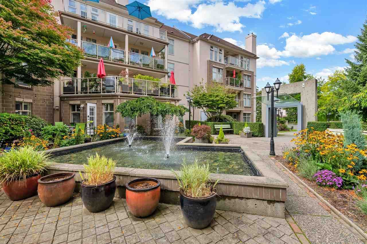 Main Photo: 309 15340 19A Avenue in Surrey: King George Corridor Condo for sale (South Surrey White Rock)  : MLS®# R2419437