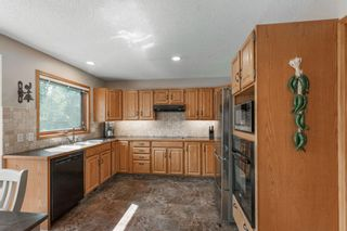 Photo 12: 75 Silverstone Road NW in Calgary: Silver Springs Detached for sale : MLS®# A1129915