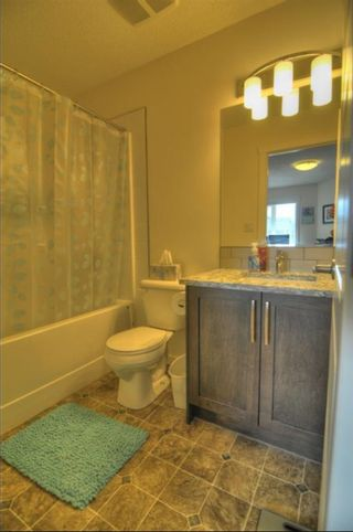 Photo 10: 403 2400 Ravenswood View SE: Airdrie Row/Townhouse for sale : MLS®# A1111114