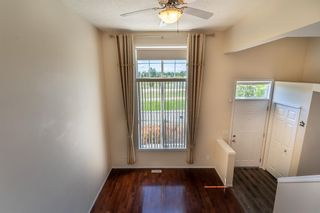 Photo 10: 119 Toscana Gardens NW in Calgary: Tuscany Row/Townhouse for sale : MLS®# A1121039