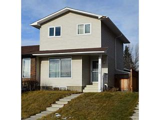 Photo 1: 3118 109 Avenue SW in Calgary: Cedarbrae Residential Attached for sale : MLS®# C3646421