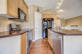 Photo 12: 411 EVERMEADOW Road SW in Calgary: Evergreen Detached for sale : MLS®# A1025224