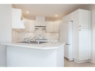 """Photo 11: 177 13888 70 Avenue in Surrey: East Newton Townhouse for sale in """"Chelsea Gardens"""" : MLS®# R2443573"""