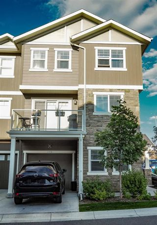 Photo 2: 308 EVANSTON Manor NW in Calgary: Evanston Row/Townhouse for sale : MLS®# A1009333