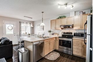 Photo 5: 30 33 Stonegate Drive NW: Airdrie Row/Townhouse for sale : MLS®# A1117438