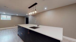 Photo 40: 14213 24A Street in Edmonton: Zone 35 House for sale : MLS®# E4262019