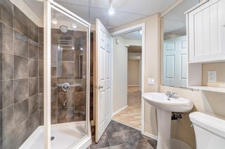 Photo 35: 32 800 Bowcroft Place: Cochrane Row/Townhouse for sale : MLS®# A1106385