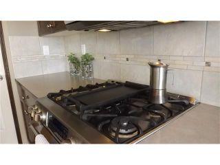 Photo 8: 155 SUNSET Close: Cochrane House for sale : MLS®# C4037159