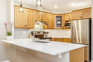 Photo 2: 1 308 14 Avenue NE in Calgary: Crescent Heights Row/Townhouse for sale : MLS®# A1101597