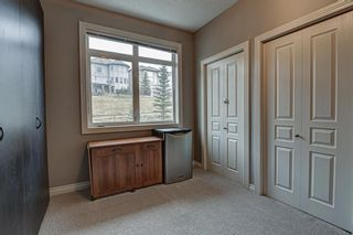 Photo 14: 7 124 Rockyledge View NW in Calgary: Rocky Ridge Row/Townhouse for sale : MLS®# A1111501