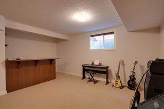 Photo 23: 97 Tuscany Glen Way NW in Calgary: Tuscany Detached for sale : MLS®# A1113696