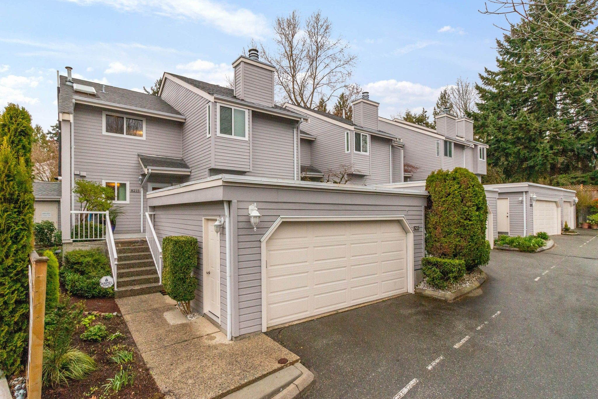 """Main Photo: 8215 STRAUSS Drive in Vancouver: Champlain Heights Townhouse for sale in """"Ashleigh Heights"""" (Vancouver East)  : MLS®# R2565596"""