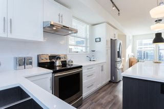 """Photo 5: 26 14905 60 Avenue in Surrey: Sullivan Station Townhouse for sale in """"The Grove at Cambridge"""" : MLS®# R2016400"""