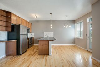 Photo 11: 8 Everridge Gardens SW in Calgary: Evergreen Row/Townhouse for sale : MLS®# A1041120