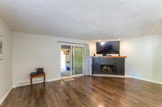 Photo 3: 19881 53 Avenue in Langley: Langley City 1/2 Duplex for sale : MLS®# R2607336